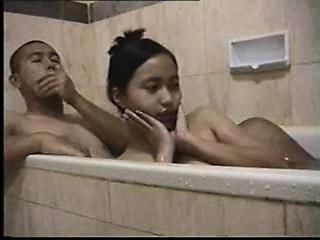 Teens bathtub foreplay