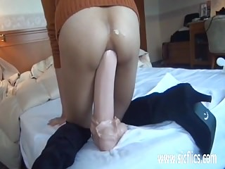 Colossal anal dildo fucking..