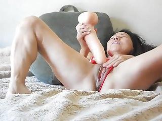 MILF with a huge dildo