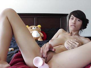 Hot asian girl plays to dildo