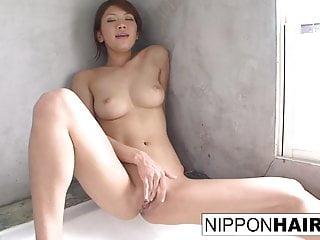 Cute Asian girl fingers her..