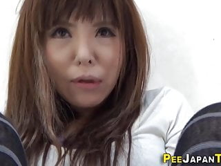 Asian in stockings pisses..