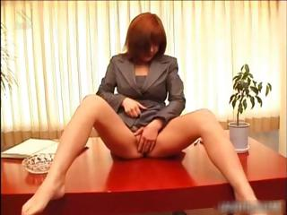Asian redhead fingering her..